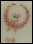 Mark with Crown Inside a Laurel Wreath